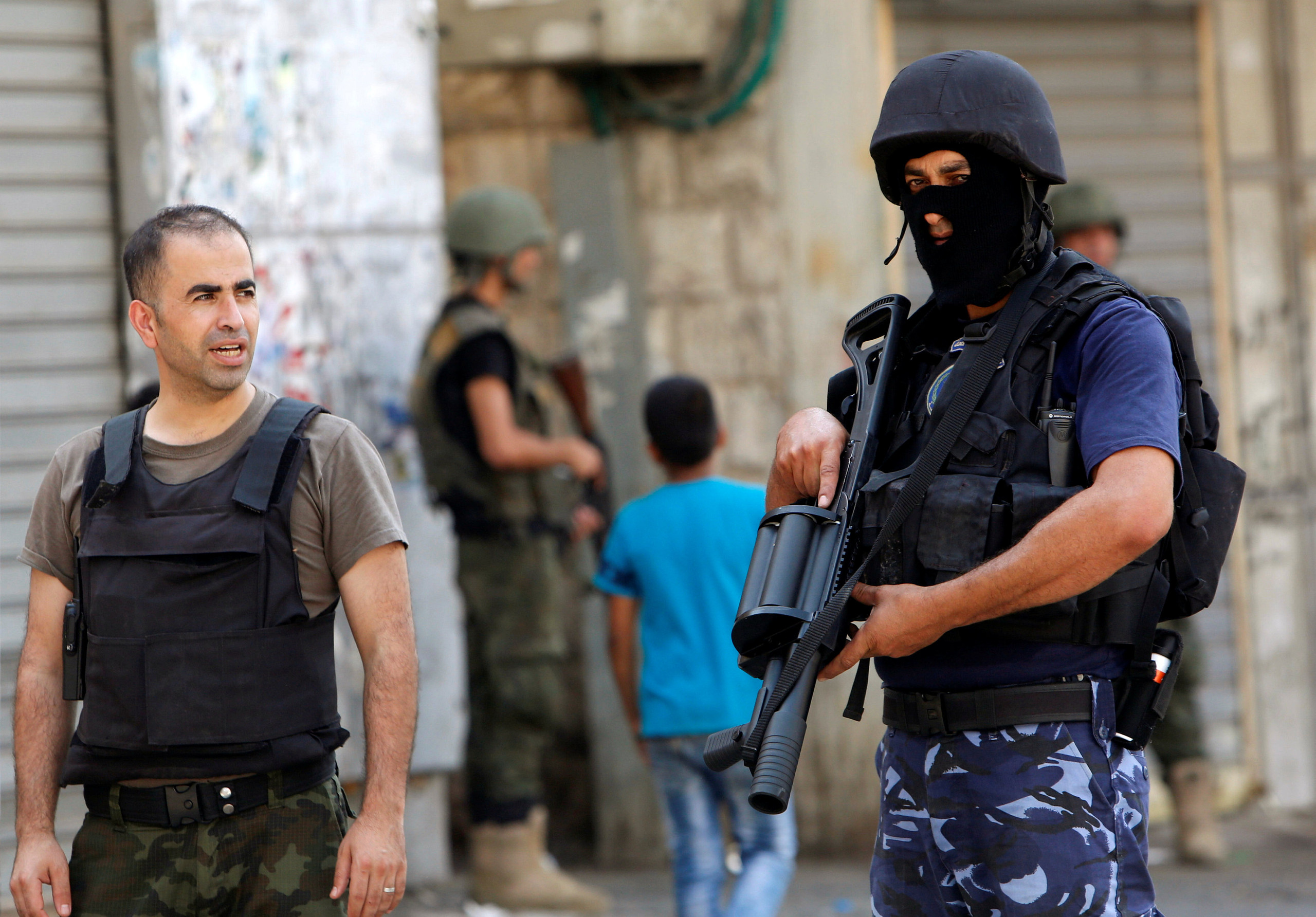 Members of Palestinian security forces take position following clashes with Palestinian youths in the old town of the West Bank city of Nablus August 23, 2016. REUTERS/Abed Omar Qusini